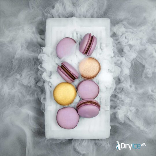 A plate of macrons with dry ice